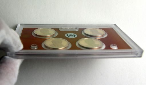 Edge View of Lens Holding 2015 Presidential $1 Proof Coins