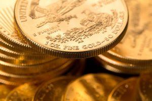 Pile of American Eagle gold bullion coins