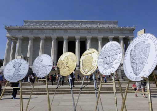 Photo of large prints of the 100th Anniversary of the National Park Service Commemorative Coins