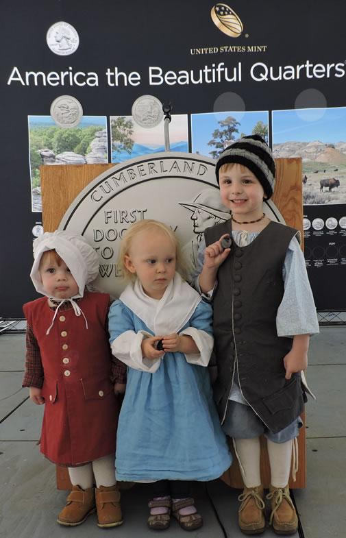 Children holding Cumberland Gap quarter