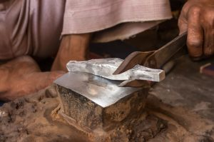 silversmith at workshop creating silver jewlery