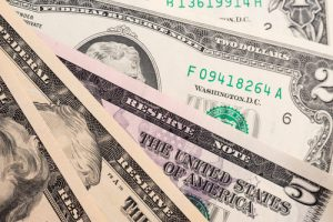 Different american dollars banknotes close-up. Background texture