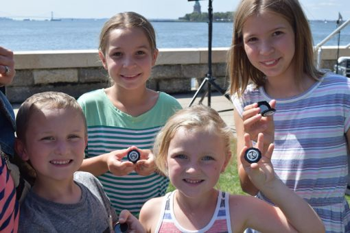 Kids with Ellis Island quarters