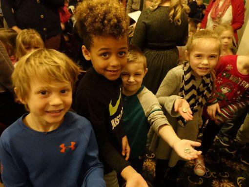 Children hold free Pictured Rocks National Lakeshore quarter