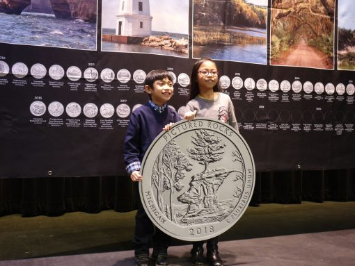 PB children pose replica quarter