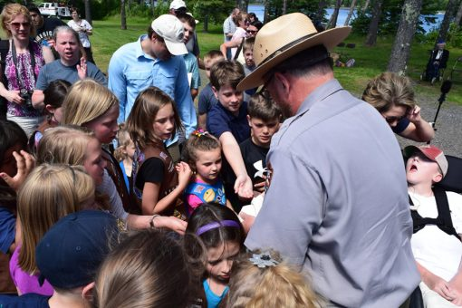 Children Receive Voyageurs quarter