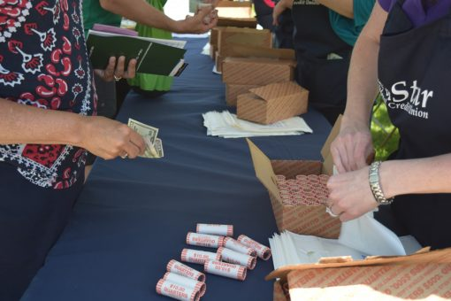 Rolls of Voyageurs quarters are exchanged