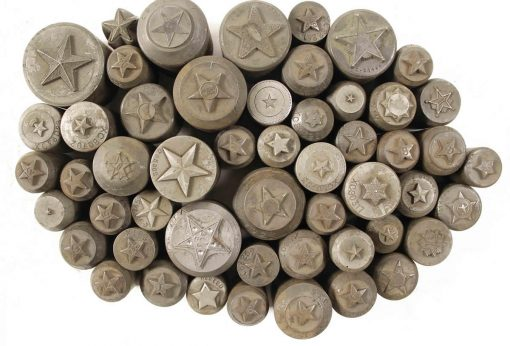 5-point star dies hubs from the Northwest Territorial Mint Historical Token Die Collection
