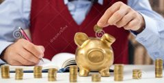 counting-money-young-accountant-male-putting-piggy-bank-41584259.jpg