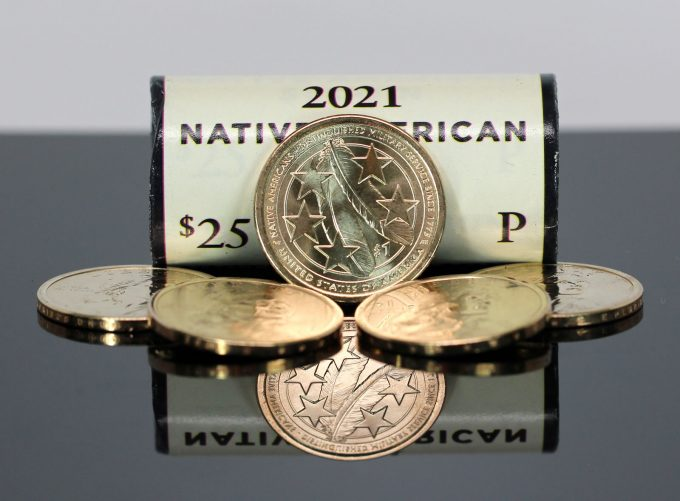 The United States Mint produced golden-colored, manganese-brass dollar coins for commerce until 2011. Federal Reserve Banks now store 1.011 billion of them. Today, the U.S. Mint strikes clad dollars but only for numismatic sales. (CoinNews photo of 2021 Native American $1 Coins.)